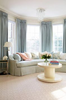 Traditional blue and white Living Room, designed by Anne Hepfer, via @sarahsarna.