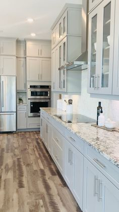 Florida Kitchen Design with wood floors, granite countertops, and custom cabinet design #kitchen ideas #floridaliving