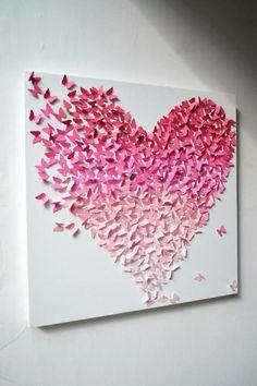 Un lindo cuadro hecho con mariposas de papel. ¡Estamos seguros que se vería súper Kool en nuestra sala de la casa!