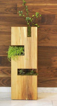 modern wooden vase for different plants