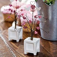 Love Bird Topiary Tree. Miniature love bird wire topiary tree studded with tiny, shimmery pink hearts and planted in a small wooden tree planter box. #faityvalentines