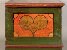 """Pook & Pook. October 24th & 25th 2008. Lot 49. Estimated: $50K - $80K. Realized: $140,400. Lehigh County, PA painted dower chest dated 1785, inscribed """"Sofia Refinger"""", decorated with 2 green sponge hearts, each with 3 pinwheels on a yellow & orange sponge ground with interlacing circle border, above 2 drawers. Bracket feet, 30"""" h., 49"""" w. For a similar example, see Fabian, The Pennsylvania-German Decorated Chest, fig. 227."""