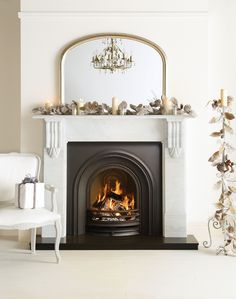 fire place with classic arched over mantel mirror - Google Search