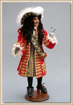 """Captain Hook (February - """"Draped in velvet, jewels, and lace, Captain James Hook appeared on the deck, and his fearful crew cheered"""". Inspired by the movie """"Hook"""". Peter Pan Halloween Costumes, Peter Pan Costumes, Halloween Ideas, Hook Movie, James Hook, Dolls Film, Jason Isaacs, Barbie Movies, Doll Costume"""