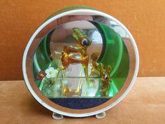 Vintage mirrored round display with 2 blown glass deer