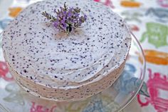 """I googling for a Lavender Cake recipe,and I came across this recipe. This is a picture of a beautiful """"Vanilla Lavender Cake"""" It is a simple layer cake made with vanilla beans,ricotta cheese,Lavender syrup with blueberries just to give it a little tinge. The frosting is made with lavender,marscapone,blueberries,and powdered sugar."""