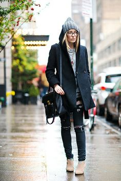 Kimberly Pesch battles the NYC rain in cozy style.