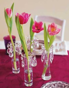 Tulips in Bud Vases    For a touch of elegance, place a glass bobeche (look for these candlestick collars where candles are sold) atop a bud vase and hang crystal lusters (we found ours at a flea market) around the edge. Finish with any single bloom that can stand on its own.
