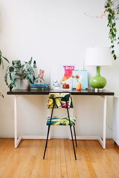 "Sneak Peek: Jon & Nina Hans ""This is my little at-home desk. I found the chair at a little furniture store here in LA called Revival, and I'm obsessed with it! It came already upholstered in that fabric, I couldn't believe it; it's like it was made for me. I also love the vase on my desk by Brett Freund. I'm such a huge fan of his work!"" #sneakpeek"