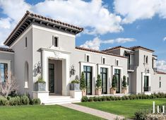 The structure, with its pristine stucco façade, clay tile roof and stately limestone trimmed French doors and windows, is every bit patrician Mediterranean on the exterior. Stucco Homes, Stucco Exterior, Grey Exterior, Exterior Homes, Exterior Paint Colors For House, Paint Colors For Home, Exterior Colors, Stucco Colors, Mediterranean Homes Exterior