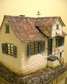 Small simple old dollhouse, not much detail. .....Rick Maccione-Dollhouse Builder www.dollhousemansions.com