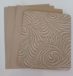 Beige craft metal.  Hand and Machine emboss.  Available in different sizes at www.creaticcastudio.co.za