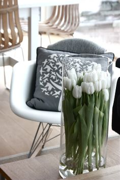 love the pillow and tulips in a tall vase
