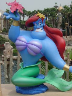 Statue of Genie from Aladdin as Ariel from The Little Mermaid. Is in the Tokyo, Japan Disney Land