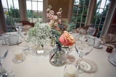 Clusters of mini vases holding soft florals.  Kiley Mullen Photography