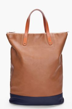 Tall rectangular leather tote bag in super soft lamb & navy w gold-tone clasp, pink & blue lining & tonal stitching. ungodly expensive but probably the softest bag ever touched, now on sale