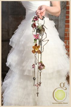Steampunk bouquet, key cascade with found objects and flowers Less dangley maybe but I like the idea of this...