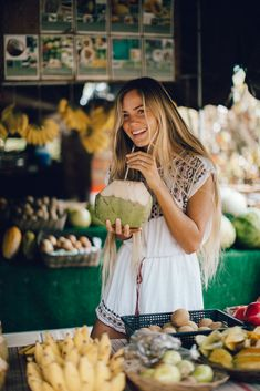 Heather Goodman Hawaii Photographer / Sippin' coconuts at the fruit stand on the North Shore of Oahu! Kawela Bay is the best spot to get fresh tropical fruit.