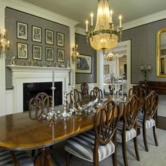 Lovely dining room with shield back chairs & a mahogany table with satinwood inlay. Isn't it nice to have a fireplace in here? Understated with a grey & white color scheme.