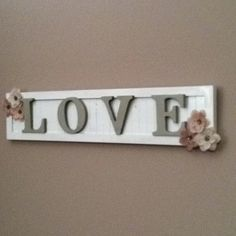 Love sign <3 repurposed wood frame sign wood letters painted & glued on with hobby lobby scrap book flowers. So easy!