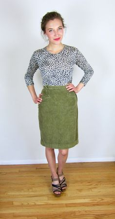 Lovely green corduroy 80s skirt. High waisted with a zipper up the side and button at the waist. Nice army green shade. Flattering and modern piece. Good condition. Brand - None Fabric - Cotton ___________________  Size - S ___________________  Length - 27 Waist - 26.5 Hips - 36 ___________________