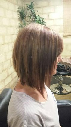 Long inverted bob. Brown with caramel highlights. Shoulder length hair.