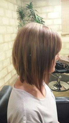 Long inverted bob. Brown with caramel highlights. Shoulder length hair.