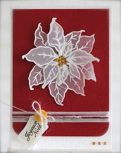 Embossed Red Poinsettia Card with a tag.