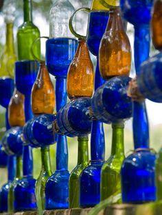 bottle garden art - some very creative ideas on this site ! Love the coke bottle chandelier! Recycled Bottles, Bottles And Jars, Recycled Glass, Glass Bottles, Bottle Candles, Wine Bottle Corks, Wine Bottle Crafts, Bottle Trees, Bottle Garden