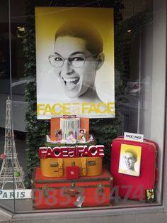 Reuse Old Suitcases in Eyewear Displays: A Face a face window display in Melbourne. By Through the looking glass retail window stylist.