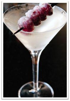 Ice Wine Martini - 2 oz ice wine, 2 oz premium vodka, frozen grapes for garnish, chilled martini glass. Pour Ice Wine into chilled martini glass, top with vodka, and stir gently. Garnish with frozen grape(s).
