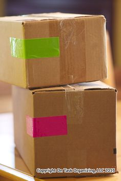 Color code moving boxes with duct tape when packing to identify the room where the box should be placed.