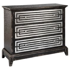 Showcasing a black finish and mirrored, geometric motif, this 3-drawer chest brings eye-catching style to your parlor or master suite.