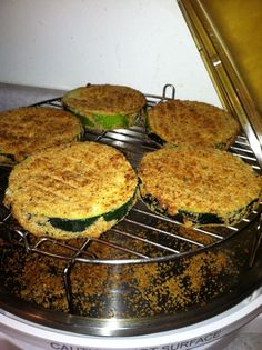 Here's Cathy R's recipe for Air-Fried Zucchini  1.In bowl, mix flour with seasoning, salt and pepper. 2.In separate bowl, whip 1 egg. 3.In third bowl, mix seasoned bread crumbs, parmesan cheese and a little olive oil for a perfect coating. 4.Dip zucchini slices in flour, then egg, then bread crumbs. 5.Place slices on 3-inch rack in NuWave Elite and cook at 400°F for 15 minutes, flipping halfway through. 6.Just before serving, top zucchini with cheese and cook for 2 minutes to melt…