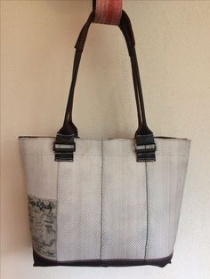 Shoulderbag made of used white firehose and leather of a used bomberjacket