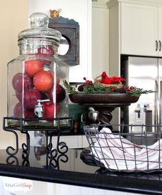 Red apples in a drink dispenser become Christmas decor. Got this idea from @Pottery Barn