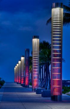 Photo about Lanters iluminating path to the beach at night in South Pointe Park, Miami Beach. Image of attraction, beach, play - 10316286 Wayfinding Signage, Signage Design, Urban Furniture, Street Furniture, Exterior Lighting, Outdoor Lighting, Area Urbana, Column Lights, Landscape Lighting Design