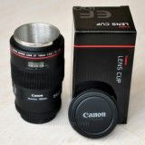 It's a travel mug made out of a Canon macro lens...totally want!