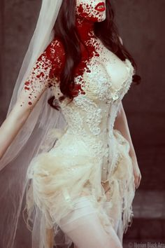 My Wedding Dress (extending the lacy material of course) and minus the blood.