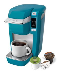 Enjoy a perfect cup of gourmet coffee anytime with this Keurig Turquoise Mini Plus Brewing System. Constructed with a durable aqua blue plastic housing, this compact little brewer is a neat, conven...