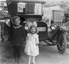 "Lois Elling, Production Editor of ""The California Nugget,"" submitted this photograph her father Herman Robinson and his sister Alice posing in front of the family car in 1918 Los Angeles."