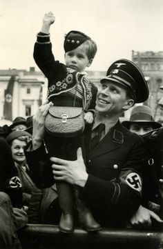 An officer of Allgemeine-SS with his young son during Hitler's 50th birthday celebration in Berlin, 1939.