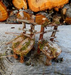 One of a kind handcrafted Fairy forest furniture set including table with pine cone umbrella and 2 woodland chairs adorned with moss. Enchanted woodland accessories for your fairy garden, miniature garden, terrarium or fairy house. This magical forest furniture set is handmade with natural materials found in the Maine woods including moss, lichen, pine cones, bark, wood, sticks and other forest finds.  The chairs measure about 3 1/4 tall by 1 1/4 wide and 1 1/2 deep The table is 2 by 3 and 4…