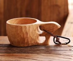 The ergonomic handle of the Wooden Kuksa Camping Mug has two slots for your fingers for a comfortable hold to last all morning.