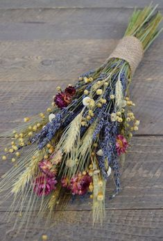 Who are my farmhouse style loving friends? Anyone want to decorate their house for them? Well, we can't all live in Waco Texas, but you can add some charm to your home with this Wildflower Lavender and Wheat bouquet. The stems are even wrapped in burlap. Lavender Bouquet, Dried Flower Bouquet, Dried Flowers, Sola Flowers, Wheat Centerpieces, Wedding Bouquets, Wedding Flowers, Globe Amaranth, Dry Plants