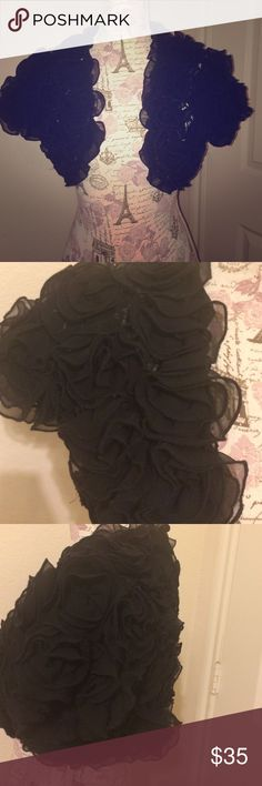 Black rose shrug Perfect black shrug with rose details. Pictures do not give it any justice! Perfect for a gorgeous plain dress that needs to become a show stopper! Sweaters Shrugs & Ponchos