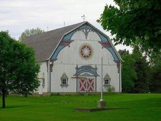 Barn love!  Frankenmuth, Michigan...  Big Red Barns and an Old Yellow Farmhouse