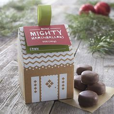 Puffy little handmade marshmallows are dipped in creamy milk chocolate for snacking, cocoa or s'mores. Fun holiday packaging makes a great stocking stuffer.