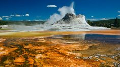 Yellowstone National Park, Wyoming, USA  Yellowstone National Park in Wyoming is another world heritage site and is the most popular national park in the USA. It is a perfect blend of green valleys, rockies, and pine dressed mountains.