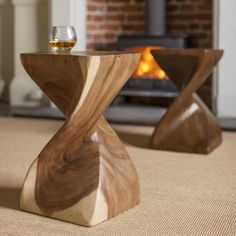 This striking Surin Twist Table is hand carved from Monkey Pod Wood. Beautiful curves and intriguing spaces add to the unique charm. Myakka